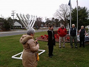 Rabbi Moesha Gourarie addresses the crowd at the lighting of the Ocean County Menorah in Manchester Township
