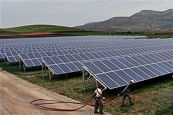 Solar Farm, by Aris Messinis, Getty Images