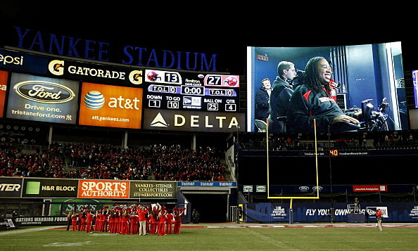 Eric LeGrand #52 of the Rutgers Scarlet Knights is show on a big screen after Rutgers' victory over the Iowa State Cyclones during the New Era Pinstripe Bowl at Yankee Stadium