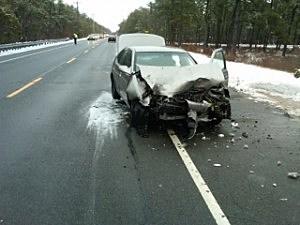 Car strikes plow