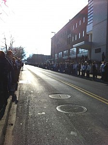 "Mourners line the Curtin Street in State College near the Creamery ice cream shop where ""Peachy Paterno"" is served."
