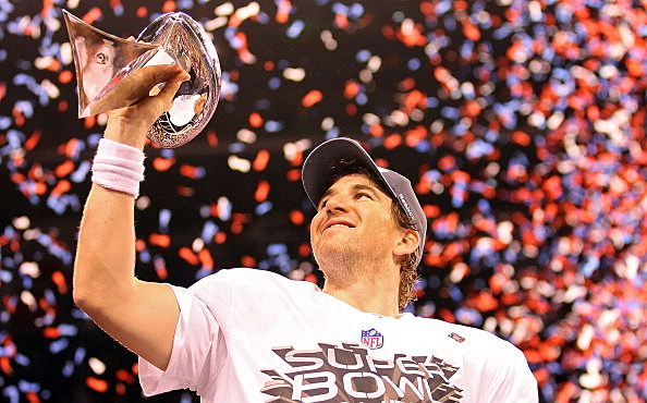 Quarterback Eli Manning #10 of the New York Giants poses with the Vince Lombardi Trophy