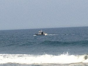 Rescue boat searches for a swimmer off Seaside Park