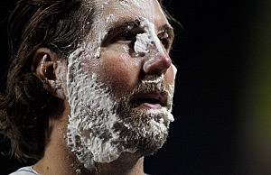 R.A. Dickey #43 of the New York Mets gets a shaving cream pie in the face after pitching a complete game one hitter against the Baltimore Orioles