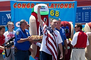 Joey Chestnut celebrates his victory after winning the Nathan's Famous International Hot Dog Eating Contest at Coney Island