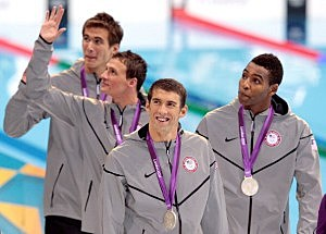 Michael Phelps of the United States and teammates Adrian Nathan (L), Ryan Lochte (2nd L) and New Jersey native Cullen Jones (R) celebrate with the silver medals won during the Men's 4 x 100m Freestyle Relay final on Day 2 of the London 2012 Olympic Games