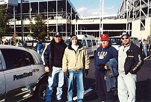 Kevin with his son Brandon, hisfather and brother at PSU game in 2002