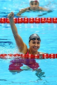 Rebecca Soni of the United States celebrates after winning gold and setting a new world record time of 2:19.59 in the Women's 200m Breaststroke Final