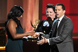 """Jon Cryer (R) accepts Outstanding Lead Actor in a Comedy Series for """"Two and a Half Men"""" from actresses Mindy Kaling and Melissa McCarthy"""