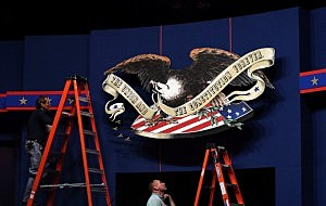 Workers make adjustments to the stage ahead of the first presidential debate at the University of Denver