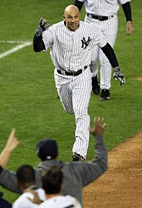 Raul Ibanez of the New York Yankees reacts after hitting a walk off home run in the bottom of the twelfth inning to defeat the Baltimore Orioles  in Game Three of the American League Division Series
