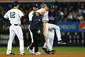 Derek Jeter being helped off the field after injuring his ankle.