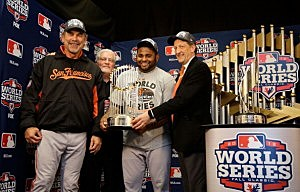 (L-R) Manager Bruce Bochy #15, Senior Vice President and General Manager Brian Sabean, MVP Pablo Sandoval #48 and Laurence M. Baer President and Chief Executive Officer of the San Francisco Giants poses with the Commissioner's Trophy after Game Four of the World Series