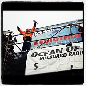 Andy Chase on the 105.7 The Hawk radiothon billboard