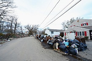 Flood-damaged belongings sit on the side of the road in a Union Beach neighborhood devastated by Superstorm Sandy