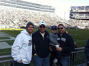 Kevin Williams (C) with son Brandon (L) and his brother Brian (holding Trevor) at Penn State