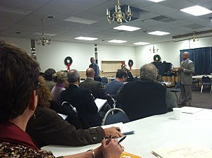 Ted Gooding (at podium)  chairman of the Ocean County Long Term Recovery Committee speaks during a recent meeting