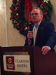 Tom River School Superintendent Frank Roselli addresses the WOBM Christmas Classic breakfast at the Clarion Hotel of Toms River