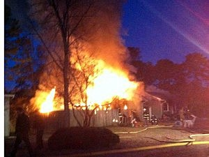 Pine Lake Park home is devoured by flames early today (Manchester Police Dept.)