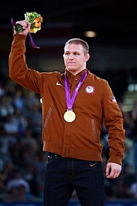 Jacob Stephen Varner of the United States celebrates with his gold medal for Men's Freestyle 96 kg Wrestling