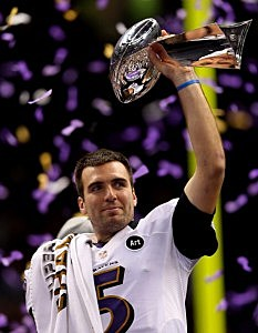 Joe Flacco of the Baltimore Ravens holds up the Vince Lombardi Trophy