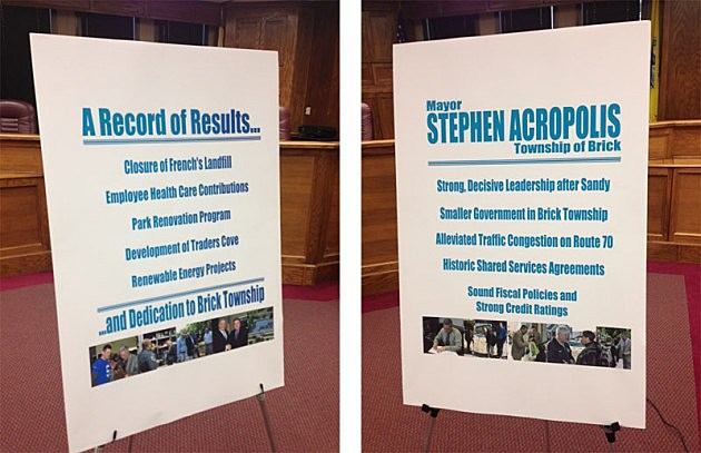 Signs touting Steve Acropolis' accomplishments as Mayor displayed at press conference