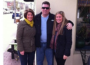 Kevin Williams with wife Jane (L) and daughter Alex (R)