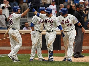 Collin Cowgill #4 of the New York Mets is greeted by John Buck #44, Daniel Murphy #28 and Ruben Tejada #11 after hitting a grand slam in the seventh inning against the San Diego Padres on opening day