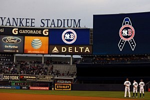 The New York Yankees observe a moment of silence to honor the victims of the Boston Marathon bombing