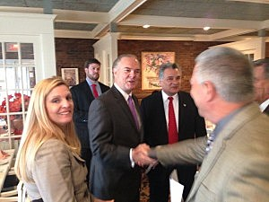 Department of Environmental Protection (DEP) Commissioner Bob Martin shakes hands with Brick Mayor Steve Acropolis as Ocean County  Freeholder Joe Vicari looks on