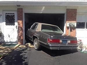 Car of Whiting 89-year-old woman who drove her car into her house twice