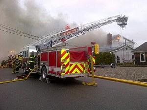 Toms River Firefighters at Snug Harbor House Fire (Toms River Police Dept.)