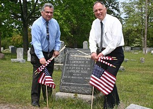 Ocean County Freeholders Joe Vicari (l) and Gerry Little (r) bedeck the grave of Civil War veteran Lawrence Berrien of Toms River