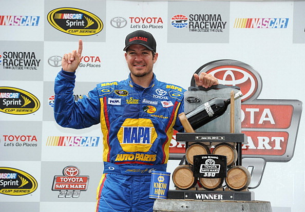 Martin Truex Jr., driver of the #56 NAPA Auto Parts Toyota, celebrates in Victory Lane after winning the NASCAR Sprint Cup Series Toyota/Save Mart 350 at Sonoma Raceway