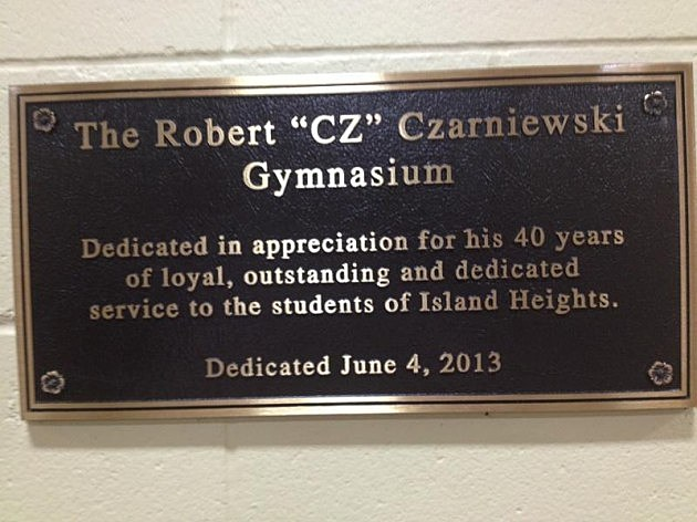 "Plaque dedicating the gym to Robert ""CZ"" Czarniewski"