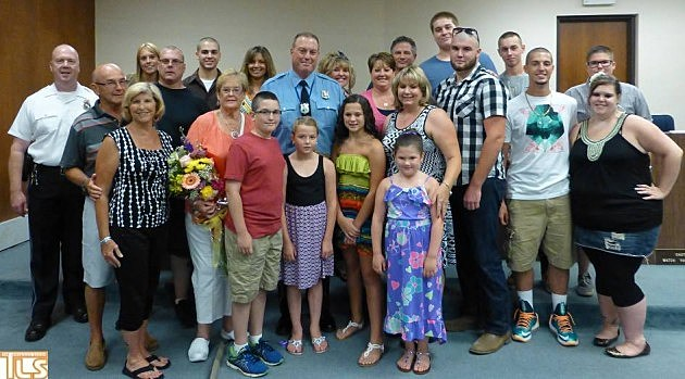 Lakewood police officer Brian Pugliese surrounded by friends and family at retirement celebration