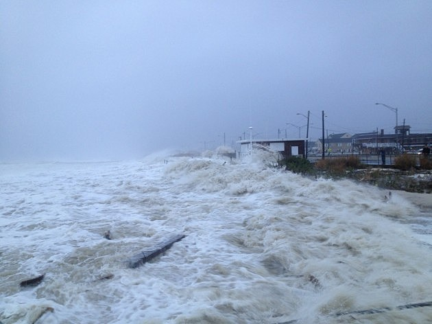 Waves from Superstorm Sandy pound the old Beach Patrol headquarters