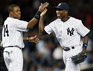Alfonso Soriano  is congratulated is congratulated by teammate Curtis Granderson
