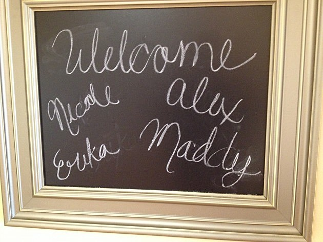 Welcoming chalkboard at Alex's apartment