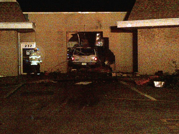An SUV that crashed into a store at the Oak Ridge Shopping Plaza