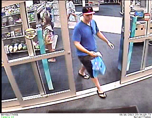 Surveillance image of suspect in car break-in