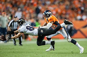 Wide receiver Brandon Stokley of the Baltimore Ravens can't haul in the pass under coverage by cornerback Chris Harris of the Denver Broncos