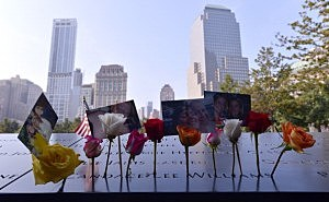 Flowers and pictures left along the North Pool at the 9/11 Memorial