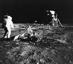 Apollo 11 astronaut Edwin 'Buzz' Aldrin deploys a scientific experiment package on the surface of the moon.