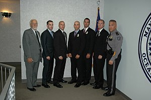 (L-R): Manchester Mayor Michael Fressola, Officer Kyle Rickvalsky, Offier Matthew Walaszek, Officer Michael Steffen, Officer Daniel Wehrle, Officer Thomas Chant and Police Chief Brian Klimakowski