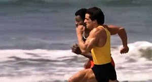Rocky and Apollo Creed run in the surf in Rocky 3
