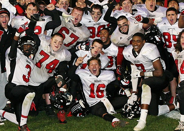 Jackson Memorial football team celebrates winning the Class  A South title