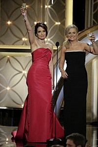 Tina Fey and Amy Poehler speak onstage during the 71st Annual Golden Globe Award