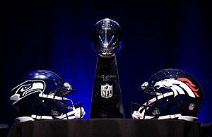 The Vince Lombardi Trophy and helmets for the Denver Broncos and the Seattle Seahawks