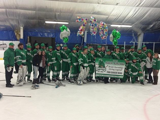 Brick High School's ice hockey team celebrates coach Bob Auriemma's 700th win